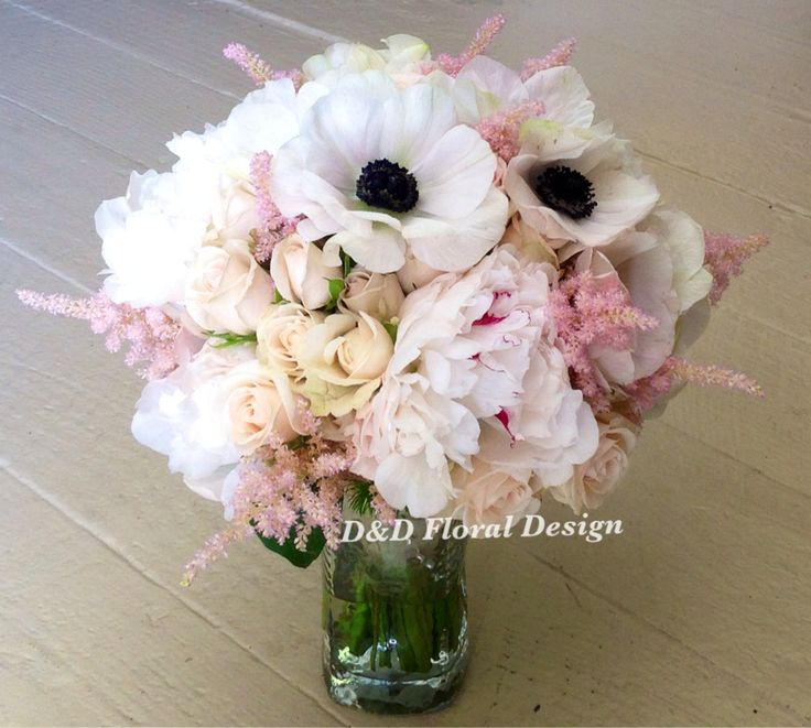 This stunning bridal bouquet has white peonies, white anemones, pale pink spray roses along with pink astilbe for a soft garden look.