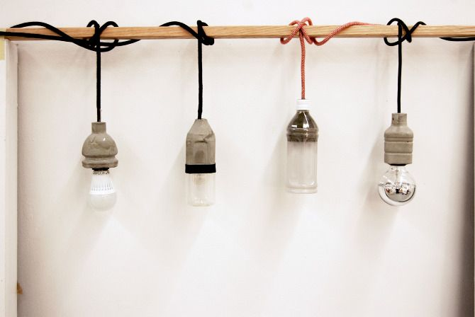 DIY concrete lamp. this is really neat- it's concrete molds from plastic water bottles, fitted over the socket for a nice industrial look. no info on the site, but could try...