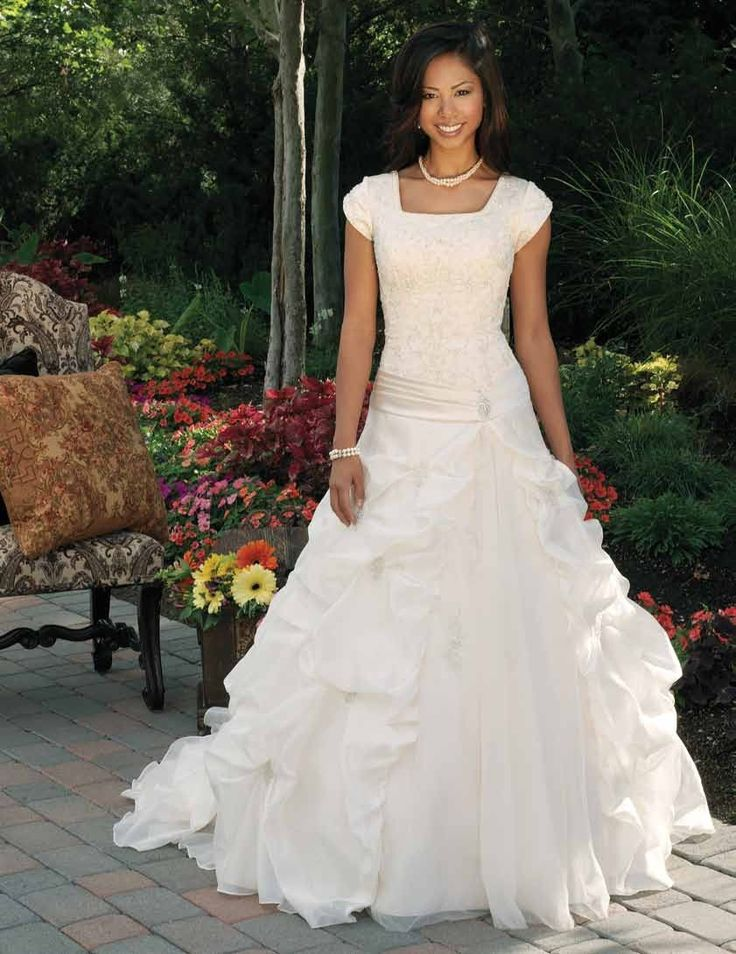 Modest Wedding Dress...love the whole think except for the part where the ruffles stop and it goes smooth.