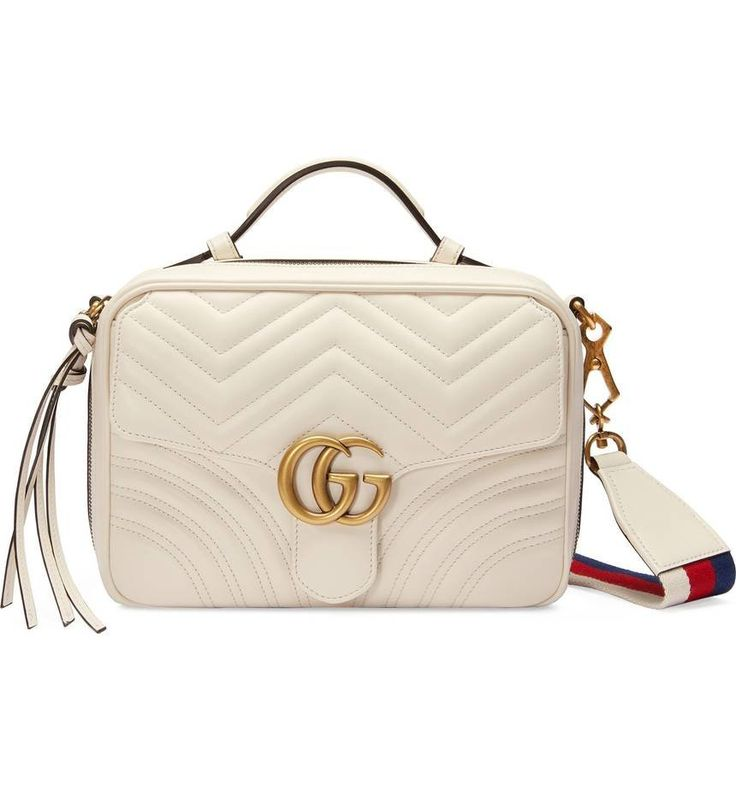 Signature chevron quilting highlights the smooth leather of a compact bag detailed with gilded double-G hardware, a stitched double-G logo at the back and a plush sueded interior. A shoulder strap in bold striped webbing lets you switch up your carry in a flash.