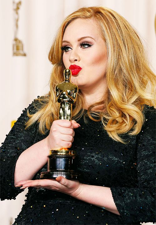Adele  She's so freakin beautiful don't care what her dress size is!!