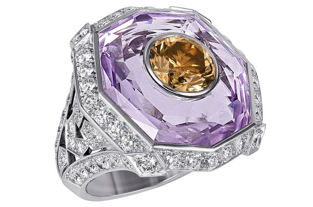 ** The jeweler's new Sortilèges de Cartier collection has 70 one-of-a-kind pieces. This platinum ring features one brown diamond within an amethyst, surrounded by brilliant-cut white diamonds....