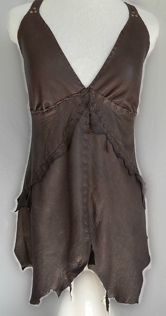 Long leather halter top made from Deer hide and Linen.  Straps are adjustable and the back is done in brown pin stripe linen