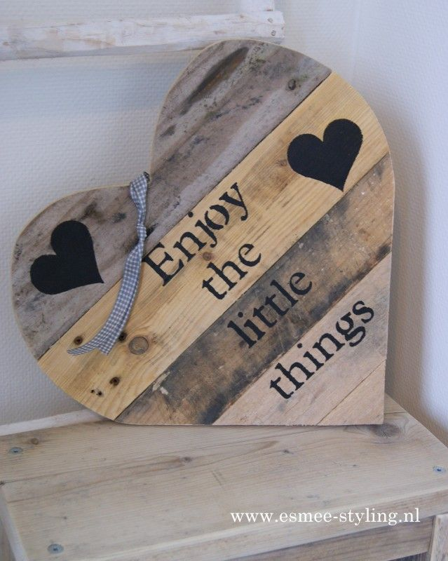 Enjoy the little things -- wooden heart of four wooden slats --- each a different color - and two black hearts