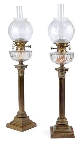 A Victorian pair of brass Corinthian column spirit lamps, with glass wells and etched shades.