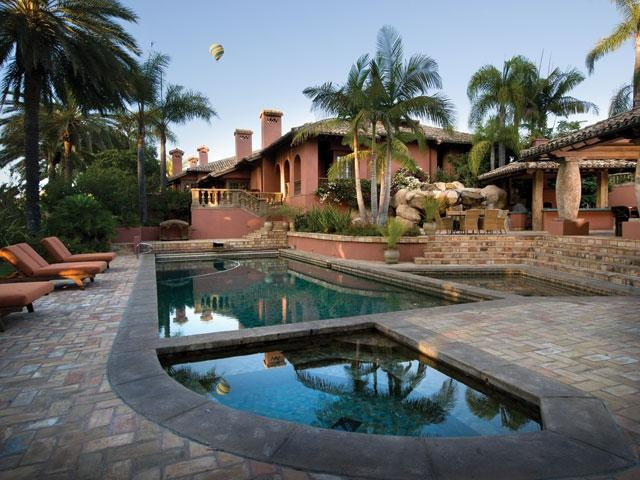 Mediterranean Style Luxury Home With Planters And Mediterranean Style Plants And Palm Trees