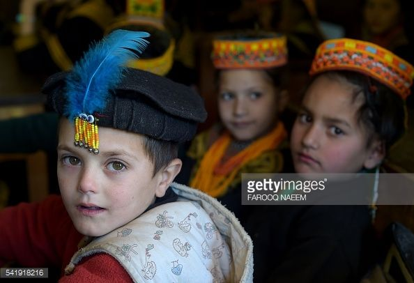 To goes with feature PAKISTAN-RELIGION-KALASH-HERITAGE by Gohar Abbas In this photograph taken on October 31, 2015, Kalash girls attend a class in a Italian build school after the massive flood in the Brun village in Bumburate valley. AFP PHOTO / Farooq NAEEM / AFP / FAROOQ