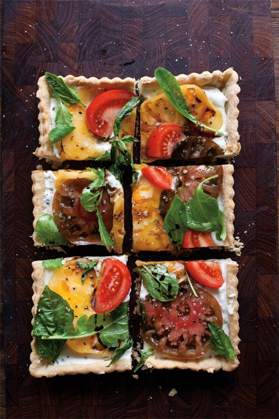Goat Cheese and Heirloom Tomato Tart | A stunning tart that showcases summer's succulent tomatoes. It's also extremely simple to make–especially if you have pastry at the ready in your freezer.