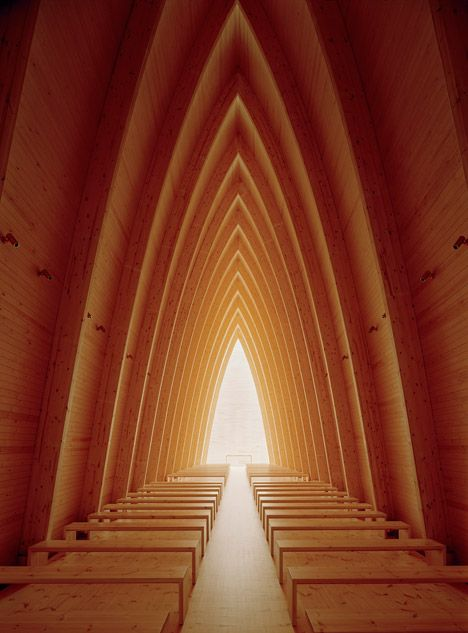 Copper-clad chapel in Finland has a curving wooden frame like a ship's hull.