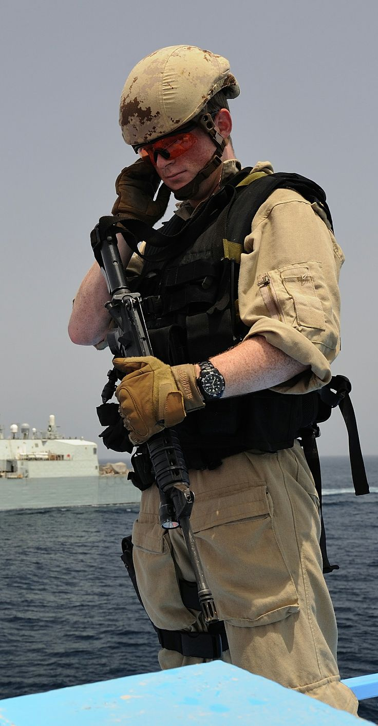 Naval boarding party member receives a radio transmission from Her Majesty's Canadian Ship TORONTO during a cargo dhow verification in the Gulf of Oman during Operation ARTEMIS on August 31, 2013 | Photo by MCpl David Singleton-Browne, Canadian Forces Combat Camera
