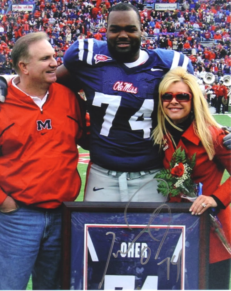 Michael Oher , and his parents... Leigh Anne and Sean Tuohy,