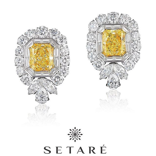 A remarkable pair of 6 carat each radiant cut yellow diamonds set in a signature…