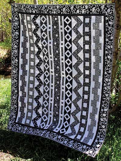 Rows-O-Rama Quilt Pattern. Believe it or not, this is a very easy quilt to make. It's just vertical rows of different blocks. There are more images in different fabrics on the website.