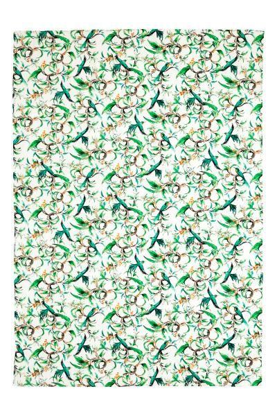 Nappe en coton à motif: Nappe en coton tissé avec motif imprimé sur le dessus.