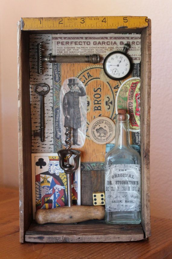 This is a mixed media assemblage contained within an old English wooden box. The box is 6.5 X 11 and it is 3 deep. The background is handmade