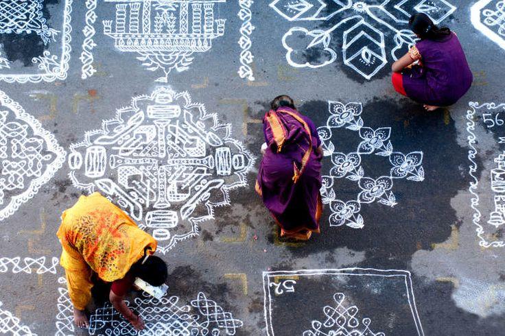 Women mark out rangoli patterns in Mylapore. Image by     Srinivasa Krishnan / Getty Images.