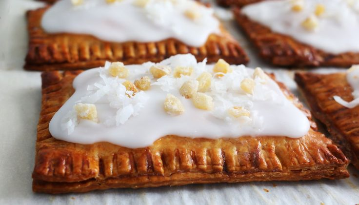 Classic toaster pastries with a tropical twist! Quick mango-ginger jam encased in readymade pie crust, spread with coconut milk glaze and finished with a shower of shredded coconut and crystalized …