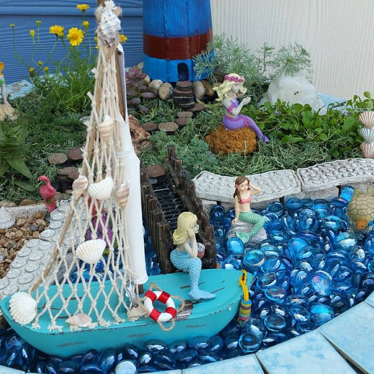 Captivating #miniaturegarden #fairygarden #beachgarden Beach Theme Fairy Garden,  Mermaid Garden