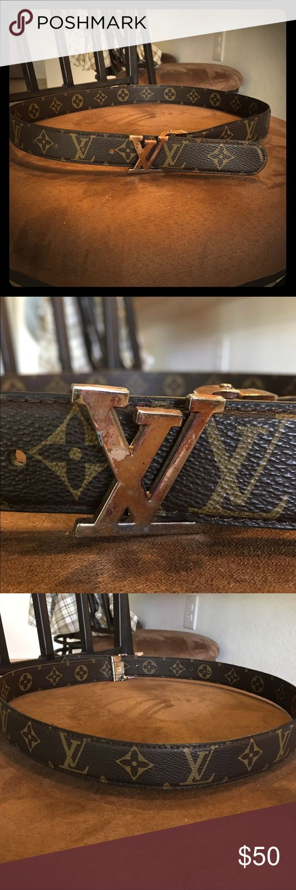 Louis Vuitton belt Louis Vuitton belt, I believe it is a replica. Fits a size small medium. The belt it's self is in great condition. The belt buckle is in mint condition with finish rubbing off. Still has a lot of wear to go though. Looks vintage 😄 Louis Vuitton Accessories Belts