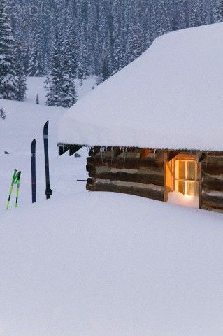 Log Cabin covered in deep snow