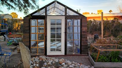 Ideas Come True: Upcycled Greenhouse Project Greenhouse made from recycled Costco carport and reclaimed door and windows.