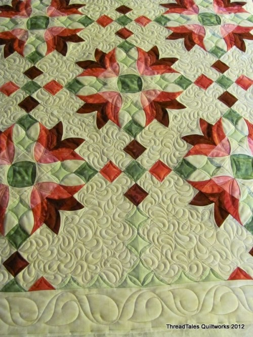 Joan's Peeled Back quilt - quilted with paisleys, continuous curve and leaves.