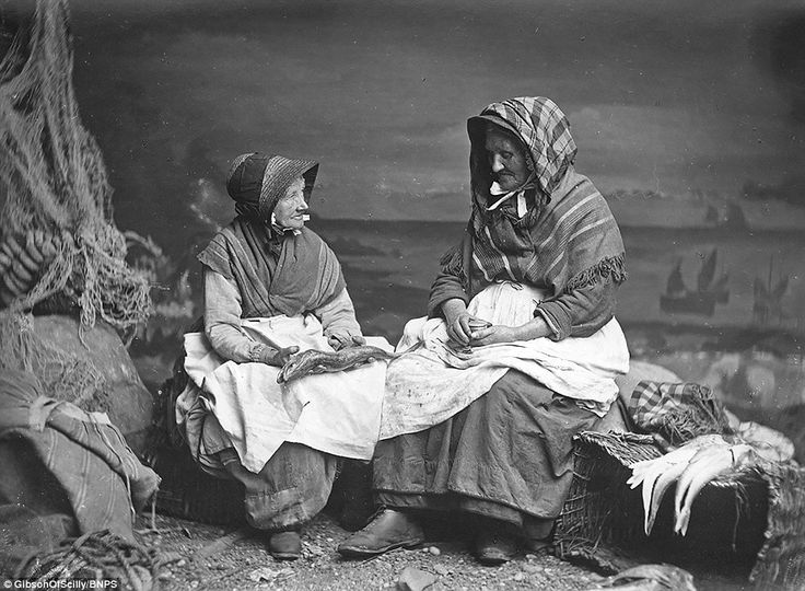 A pair of weather-beaten Cornish fishwives pose for a photograph in one of the Gibsons' st...