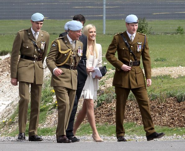 Prince Charles, Prince of Wales, Prince Harry and Chelsy Davy attend Prince Harry's Pilot Course Graduation at the Army Aviation Centre on May 7, 2010 in Andover, England. The Prince of Wales, Colonel in Chief, presented flying badges to students, including Prince Harry who had successfully completed the Operational Training Phase of the Army Air Corps. It was announced today that Prince Harry will fly Apache helicopters during the next section of his training