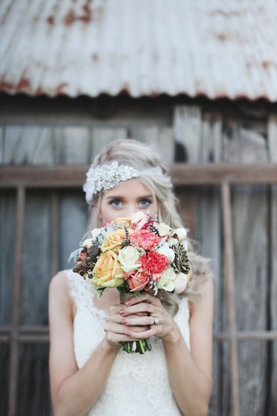 Cute bohemian bride with a gorgeous bouquet!