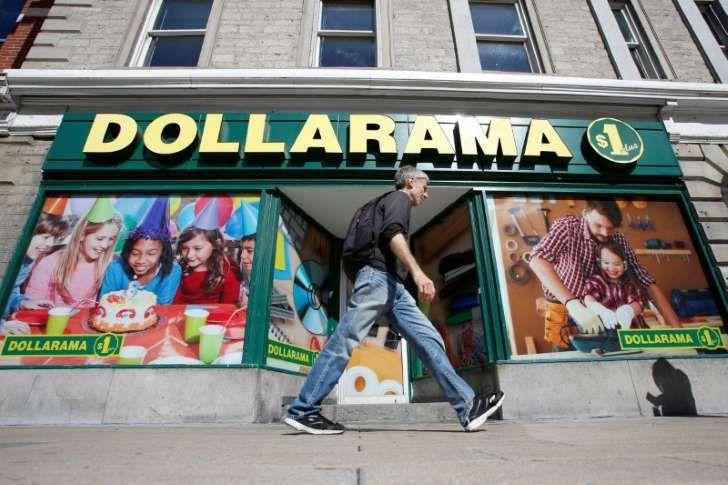 A pedestrian walks past a Dollarama store in Ottawa