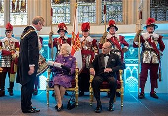 Lord Mayor of the City of London Jeffrey Mountevans (left) makes a presentation to Queen Elizabeth II and Prince Philip, Duke of Edinburgh during a reception for the High Commissioners' Banquet to mark Commonwealth Week at the Guildhall on March 16, 2016 in London, United Kingdom.