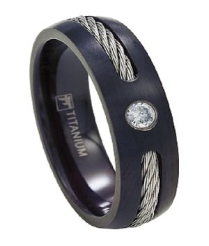 US$ On sale: $37.95 One of the latest styles in titanium wedding band rings for men, this 7mm ring starts with a matte black finish which reveals an underlying steel cable. But the centerpiece of this alternative ring is a single sparkling CZ.