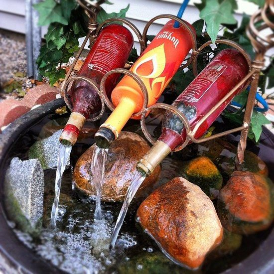 Up-cycle Old Wine Bottles in a Garden Water Feature