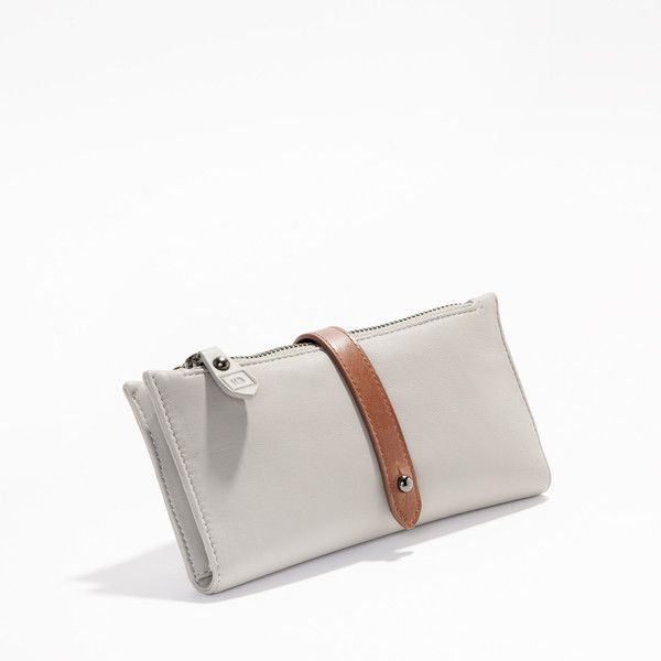 A stylish, Limited Edition ladies wallet made of high quality beautiful soft leather with dark tan leather trims and lined with 100% cotton.