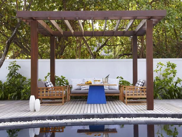 The dark wood pergola complements the light wood outdoor furniture. >>  http://www.hgtv.com/decks-patios-porches-and-pools/15-lounge-worthy-poolside-patios/pictures/page-4.html?soc=pinterest
