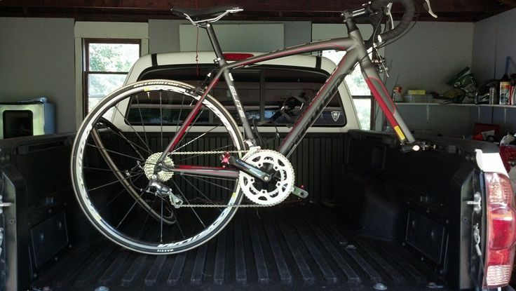 Specialized beauty secured with a truck bed rail mounted bike rack! Extremely economical rack and your bike is extremely safe in the truck bed.