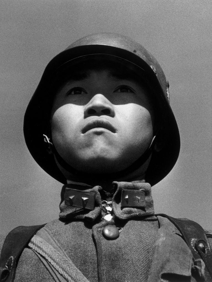 Boy soldier, Hankou, China, by Robert Capa http://i.imgur.com/PkXKT.jpg