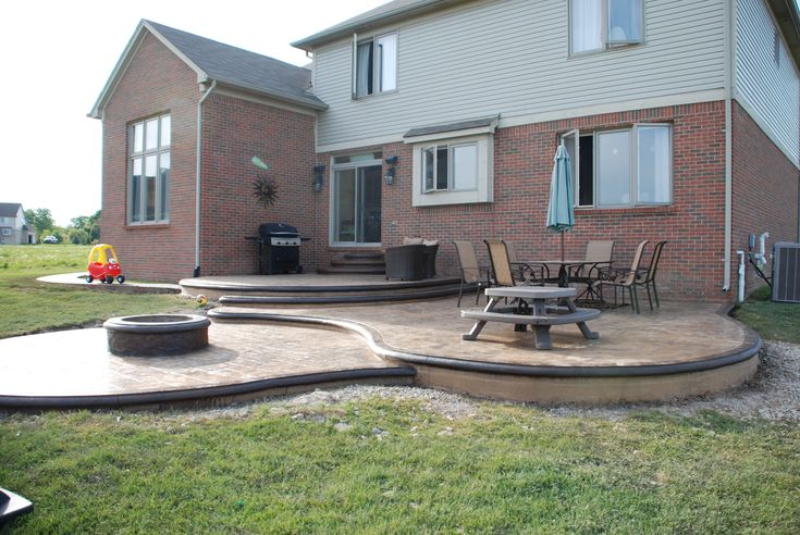Custom Designed Stamped Concrete Patio W Built In Fire Pit