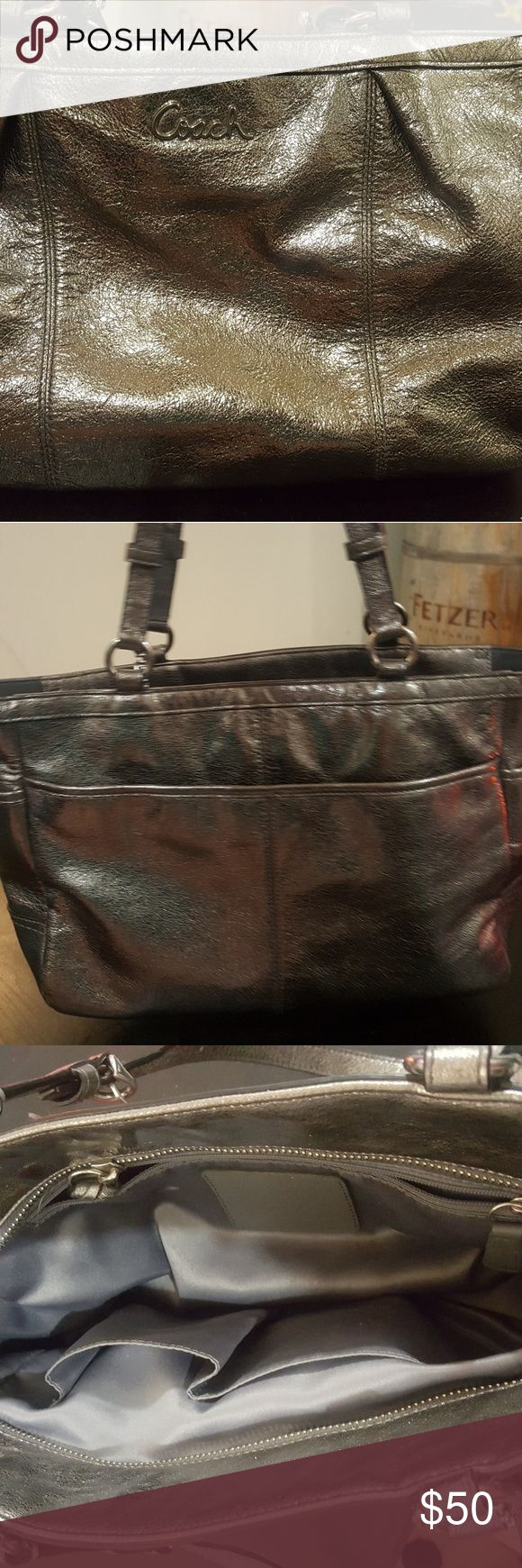 Coach silver shoulder bag Well loved silver coach bag, shoulder length. Inside lining has some spills that could be easily hand washed. The outside is perfect, no flaws. Coach Bags Shoulder Bags
