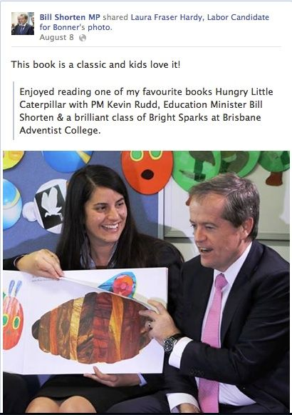 Minister for Employment and Workplace Relations reading The Very Hungry Caterpillar