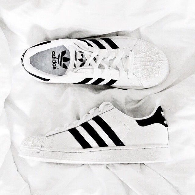 Black and White - classic white Adidas Superstars with black detailing
