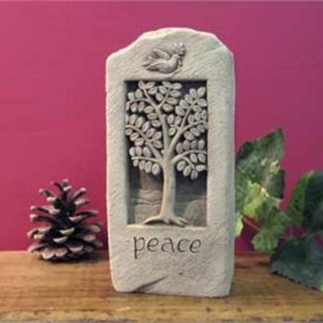 Peace Stone - Notice the dove carrying an olive branch and the tree itself which symbolizes growth and rebirth. The Peace Stone statue is purchased year round as a gift for a variety of occasions. Often used as a house warming gift, everyday gift or a piece of garden art. You can't go wrong giving a gift of peace.  Image is Aged, other options are Natural, Green, Terra Cotta and Designer White Dimensions: 6.75 x 3.25 x 1.50 Composition: Hand Cast Stone