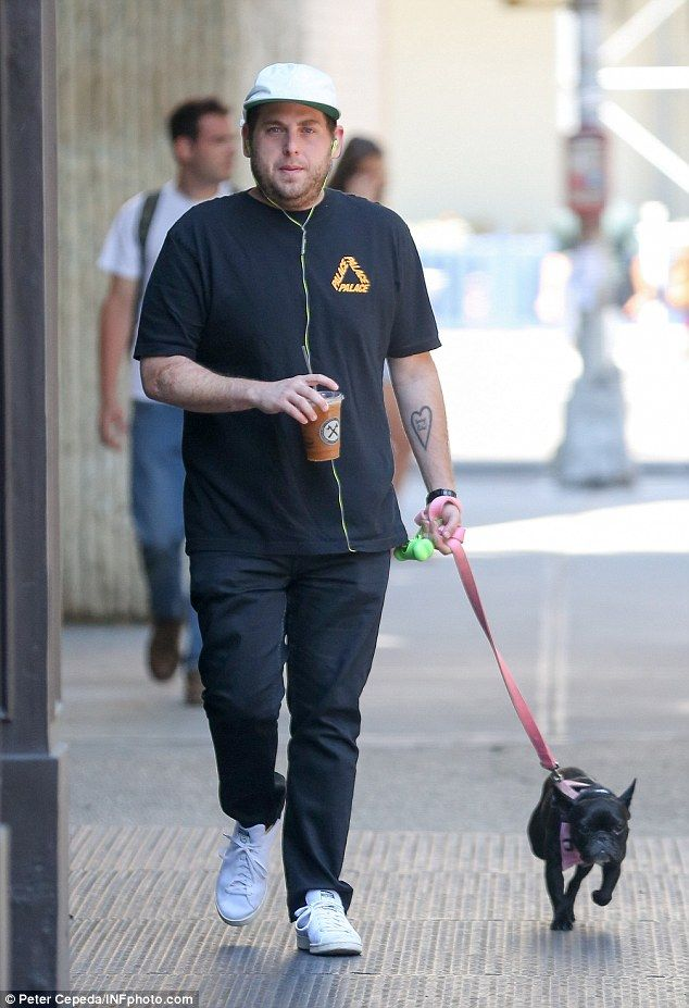 Fitter than ever: Jonah Hill appeared to have bounced back to quite a trim version of himself, stepping out in New York City to grab coffee with his precious pooch in tow on Wednesday