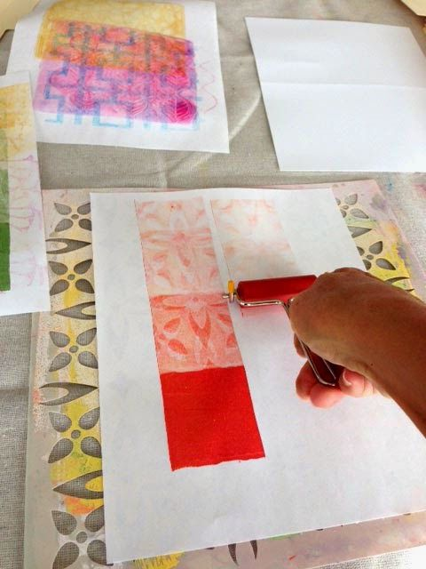 Gonna Stuff a Chicken: Let's call it the hidden stencil technique. I roll paint onto my Gelli Plate by using a brayer that is inked in paint. I like to clean it off by rolling it onto a separate paper that I keep beside my Gelli. For some reason this time, I set the paper on a stencil and rolled the brayer across to clean it.