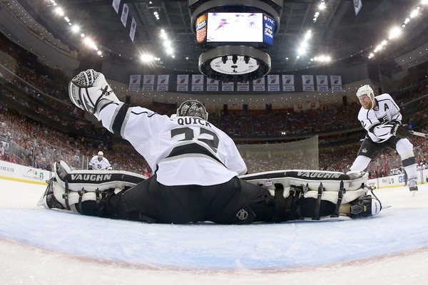 Kings goalie Jonathan Quick makes a save during the first period in Game 1 of the Stanley Cup Final on Wednesday.