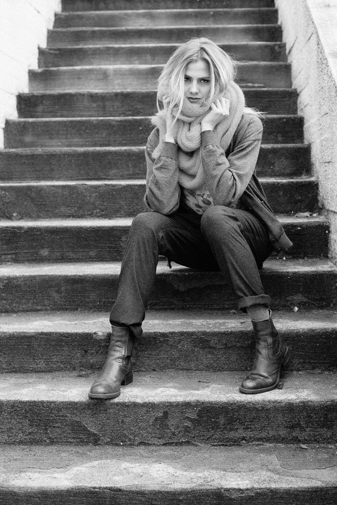 On the steps wrapped up in wool.