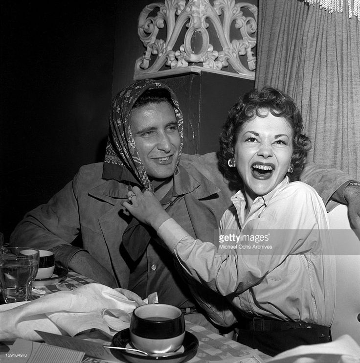 Actress Helene Stanley hams it up with LA gangster Johnny Stompanato at Ciro's nightclub on May 24 1954 in Los Angeles, California.