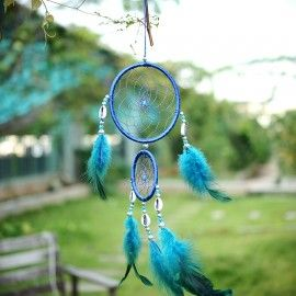 Dream catcher wall hanging made up of sea shells, feathers, thread and ring