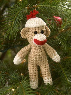 Little sock monkey ornament, free pattern from Red Heart    . . . .   ღTrish W ~ http://www.pinterest.com/trishw/  . . . .  #crochet #amigurumi