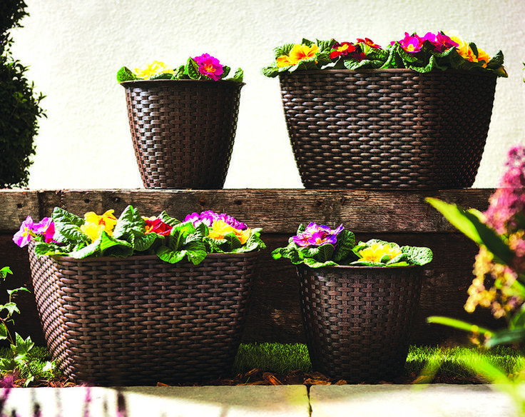 SET OF 4 RATTAN PLANTERS - GARDEN   Contemporary style, durable Rattan effect garden planters made from weather resistant polypropylene. Set of 4 in two different sizes: 2 x square Planters: size H19 x W29 x D29cm top, 23 x 23cm base; and 2 x Pound Planters, size H17 x diam. 20cm at top, 12.5cm diameter at base.